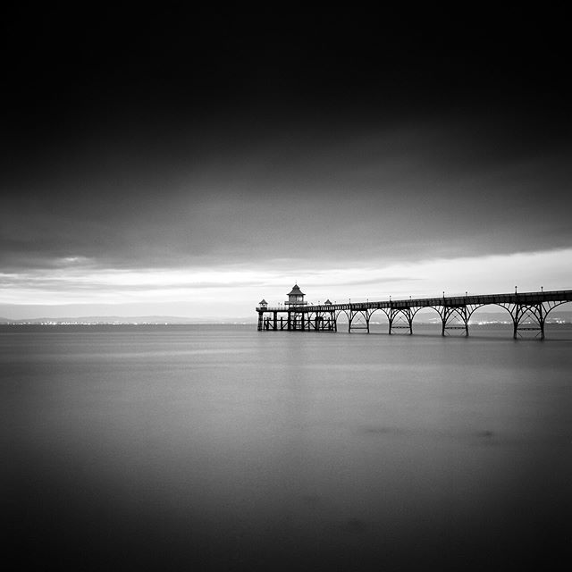 My Print Store is open again for Christmas. This is mainly personal black & white work shot over the last 20 years. This is Clevedon Pier in Somerset shot using my trusty Rolleiflex with Ilford Pan F film. Link in my bio #clevedonpier #jasoningramprints #rolleiflex #panf #blackandwhitephoto #blackandwhitephotography #landscapephotography #seascapephotography #somerset